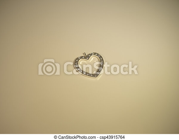 Glowing heart on a cream background - csp43915764