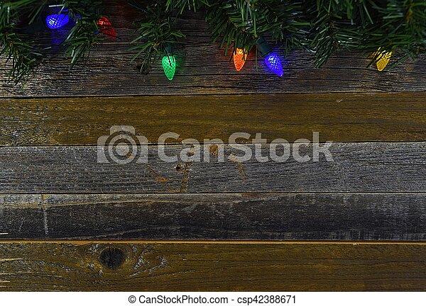 glowing lights on barn wood - csp42388671
