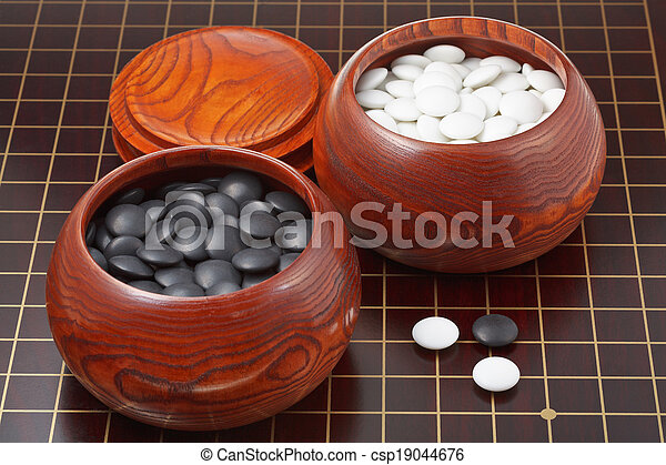 Black And White Go Game Stones And Wooden Bowls On Wood Board Best Game With Stones And Wooden Board