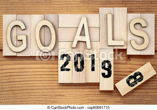 goals 2018 change to 2019 concept. Wooden block cube with number on table - csp60691710