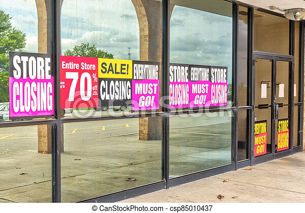 Going Out of Business Signs in Retail Store Windows - csp85010437