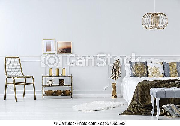Gold accents in bedroom - csp57565592