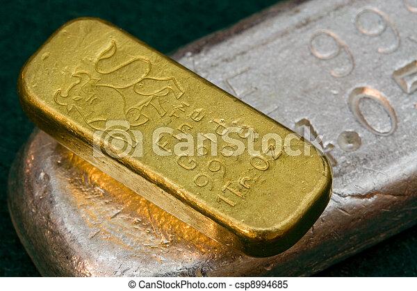 Gold and Silver Bullion Bars - csp8994685