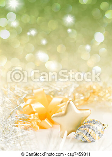 Gold and silver Christmas baubles on background of defocused golden lights - csp7459311