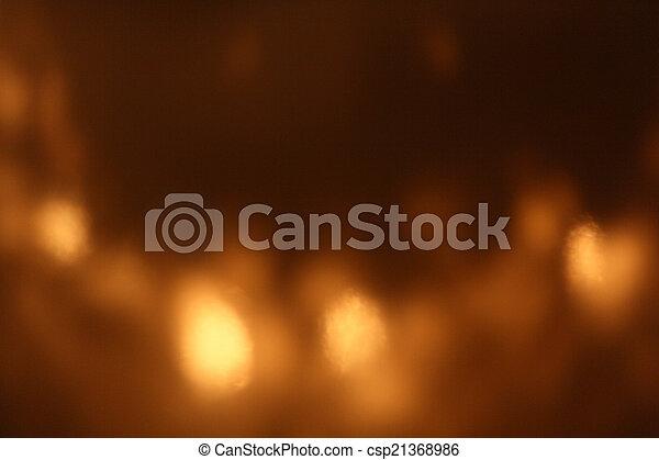 Gold bokeh on black background - csp21368986
