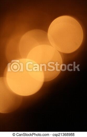 Gold bokeh on black background - csp21368988