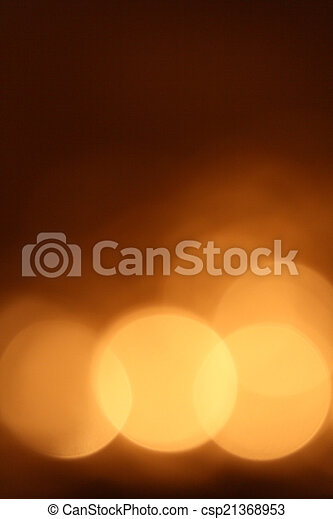 Gold bokeh on black background - csp21368953