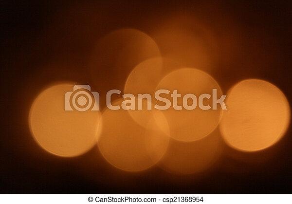 Gold bokeh on black background - csp21368954