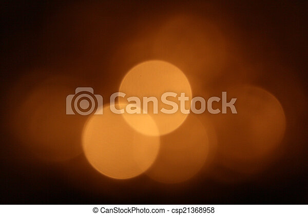 Gold bokeh on black background - csp21368958