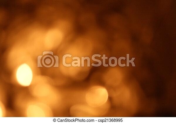 Gold bokeh on black background - csp21368995