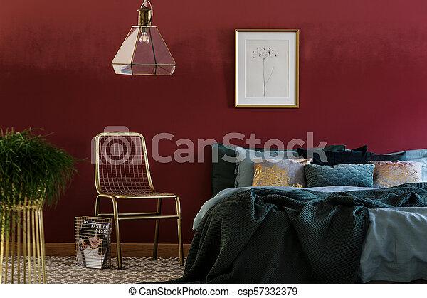 Gold chair in bedroom interior - csp57332379