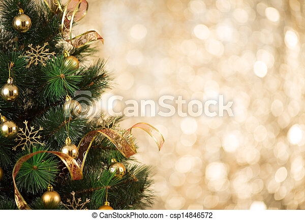 Gold Christmas background of defocused lights with decorated tree - csp14846572