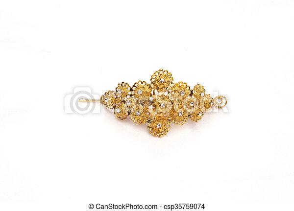gold colour barrette on white background - csp35759074