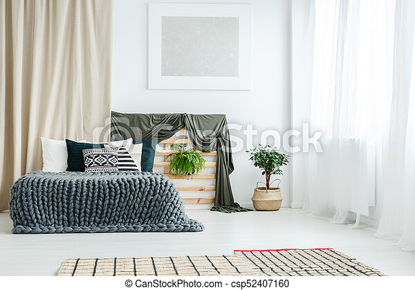 Gold curtain in bedroom interior - csp52407160