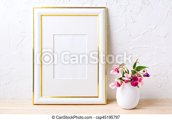 Gold decorated frame mockup with flower bouquet in flowerpot . empty ...