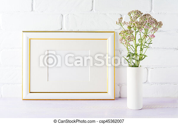 Gold decorated landscape frame mockup with wild creamy pink flowers ...