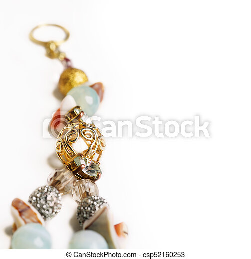 gold detail of bijouterie with semiprecious at white background - csp52160253