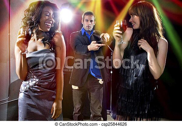 Gold Diggers at a Nightclub - csp25844626