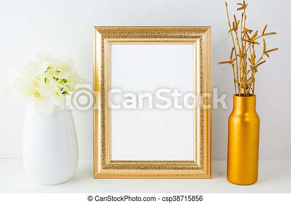 719b9e141ede Gold frame mockup with golden vase and ivory hydrangea. Frame mockup ...