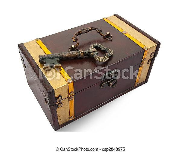 Gold key on treasure chest - csp2848975