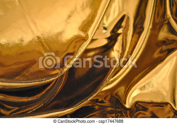 Gold lame cloth drapery background. - csp17447688