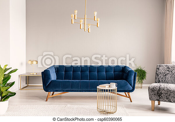 Gold Lamp Hanging Above Royal Blue Sofa In Real Photo Of Light Grey Sitting Room Interior With Empty Wall Canstock