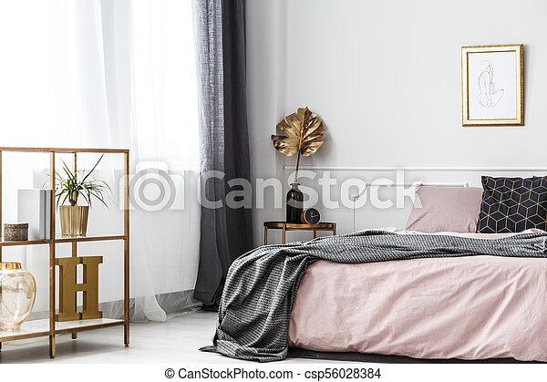 Gold leaf in bedroom interior - csp56028384