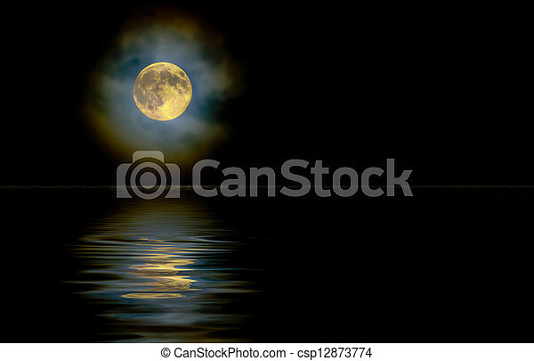 Gold moon through high clouds with reflection - csp12873774