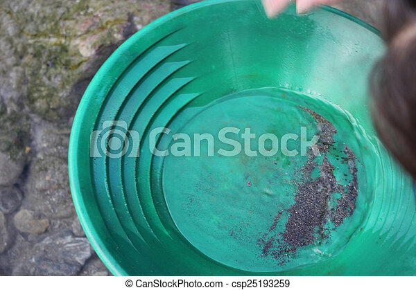 Gold Nugget mining from the River - csp25193259
