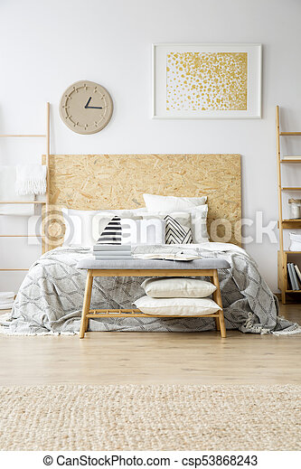 Gold painting in boho bedroom - csp53868243