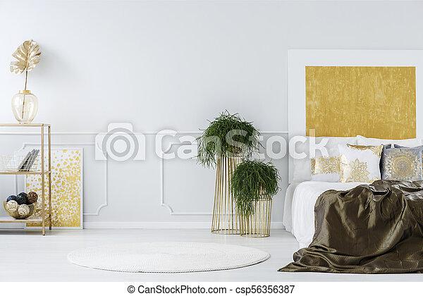 Gold painting in elegant bedroom - csp56356387