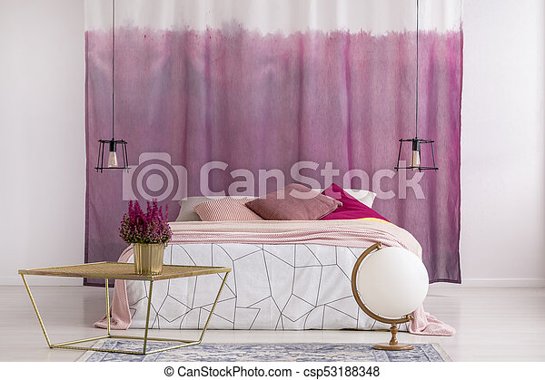 Gold table in pink bedroom - csp53188348