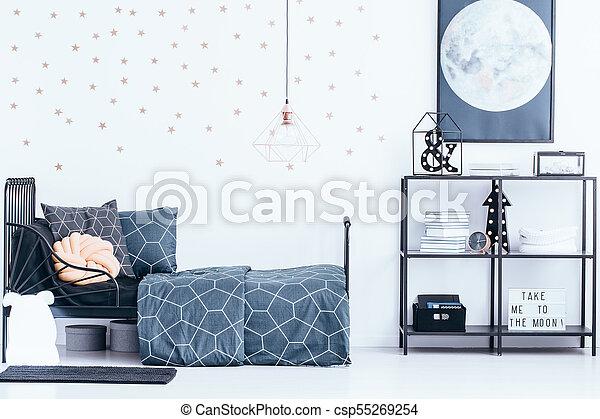 Gold wallpaper in teenager's bedroom - csp55269254