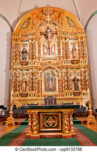 Golden Altar at Mission Basilica San Juan Capistrano Church California. This is the successor church to the Mission founded by Father Junipero Serra in 1775. - csp9133788