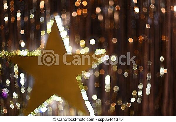 golden background with glowing star and beautiful bokeh - csp85441375