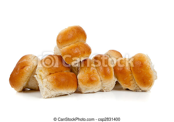 Golden baked dinner rolls on a white background - csp2831400