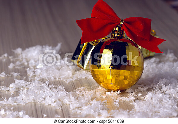 Golden ball with a red bow - csp15811839