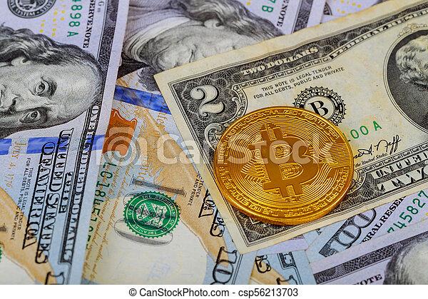 golden bitcoin coin on us dollars close up - csp56213703