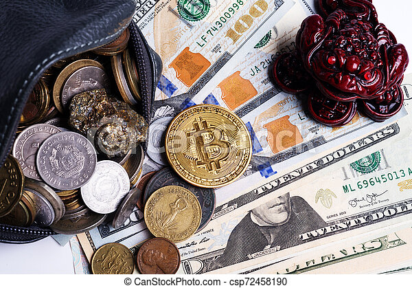 golden bitcoin coin over dollars and wallet with international coins and money toad. close up - csp72458190