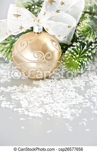 golden christmas ball with ribbon - csp26577656