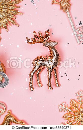 Golden christmas decotartive deer on pink pastel background. - csp63540371
