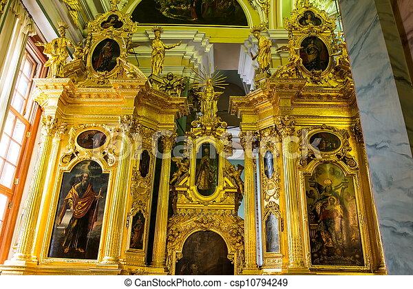 Golden church wall decoration taken in russian church indoor in summer.