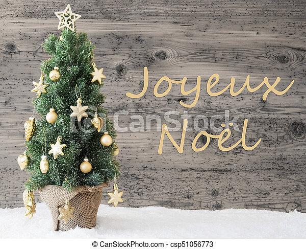 foto de Golden decorated tree, joyeux noel means merry christmas. French ...