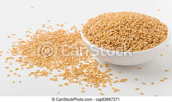 Golden flaxseed in bowl - csp63667371