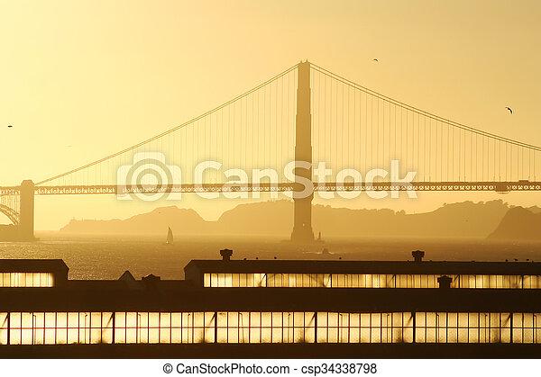 Golden gate bridge at sunset - csp34338798