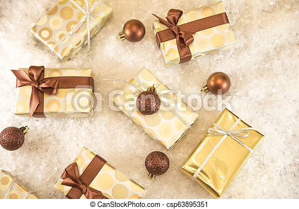 golden gift boxes and Christmas decorations - csp63895351
