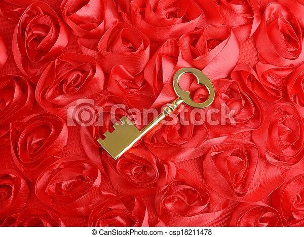 golden Key with rose petals as a symbol of love - csp18211478