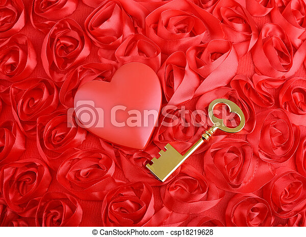 golden Key with rose petals as a symbol of love - csp18219628