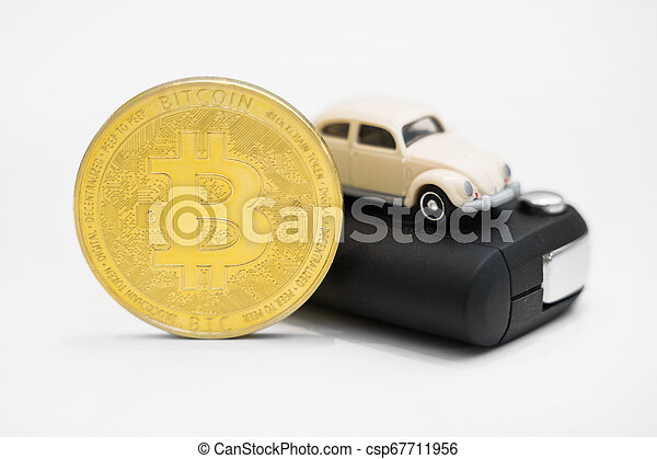 Golden physical bitcoin and car key on white background. - csp67711956