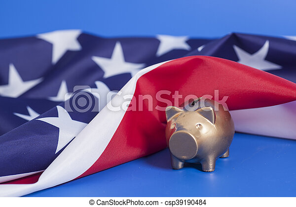 Golden Piggy Bank  with American Flag on blue background - csp39190484